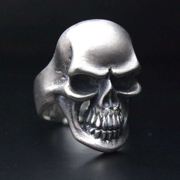 Large solid silver rock'n'roll skull ring