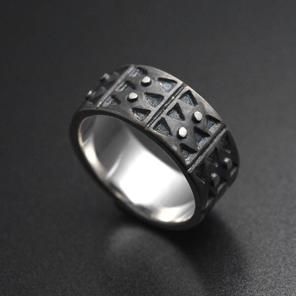 Contemporary ethnic style silver wedding ring