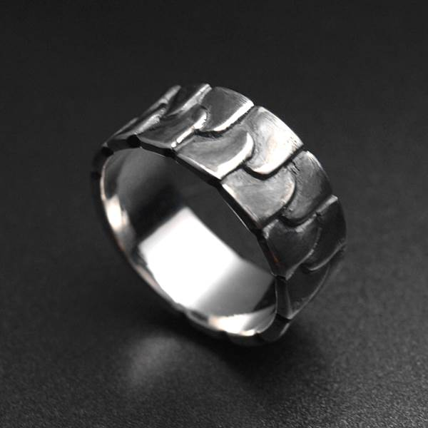 Contemporary silver ring with interwoven geometric patterns