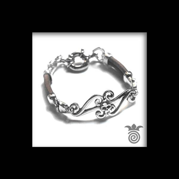 Silver and leather skull bracelet