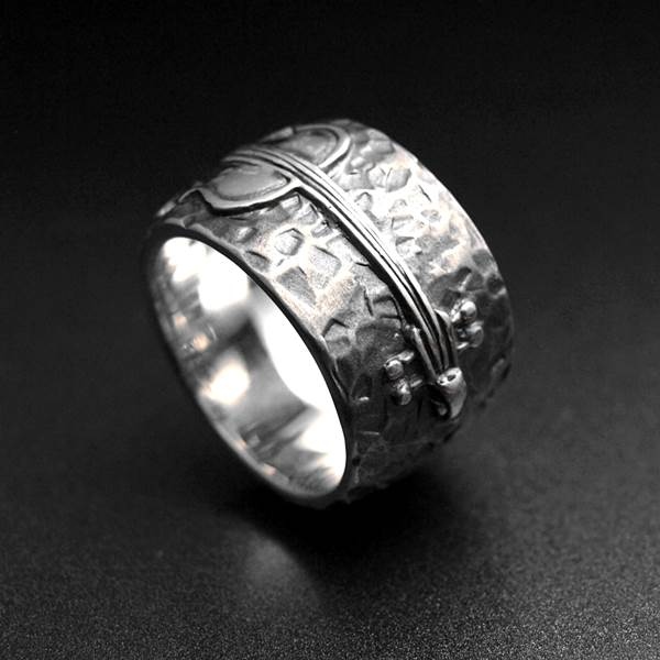Large silver ring with cello