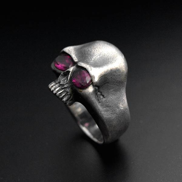Silver ring with skull and stones in the eyes